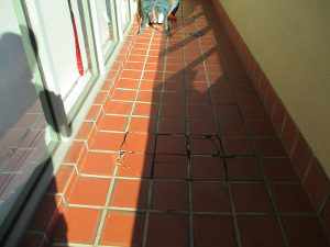 Cracked tiles on patio